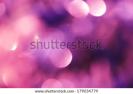 Abstract background with bokeh defocused lights and shadow.Multicolors bokeh.Vintage style.Disco purple lights. - stock photo