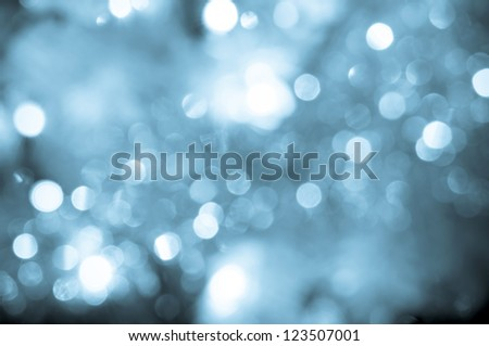 Abstract background with bokeh effect - blue toned image of defocused lights - stock photo