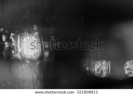 Abstract background with defocused lights. Black and white.