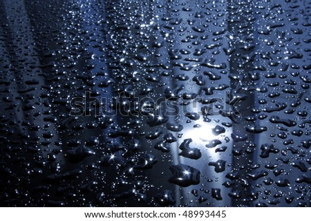 Abstract background with drops in back lit