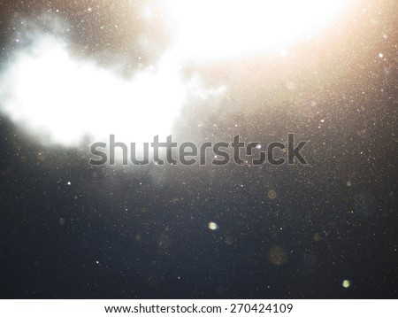 Abstract background with floating dust and garnish with translucent clouds - stock photo