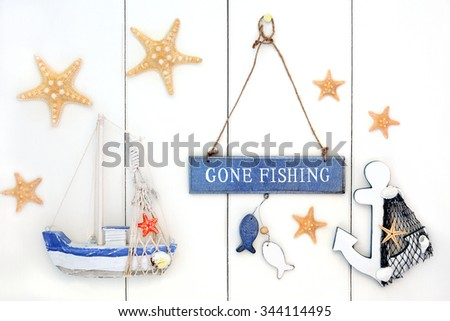 Abstract background with gone fishing sign, starfish, decorative anchor and boat over white wood.   - stock photo