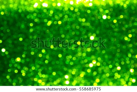 Abstract background with green blurred bokeh lights