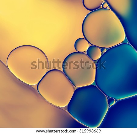 Abstract background with oil drops on water. - stock photo