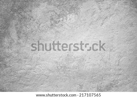 abstract  background with rough distressed aged texture, grunge charcoal gray color background for vintage style cards or web backgrounds or brochure backdrop for ads or other graphic art images - stock photo