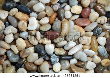 abstract background with round pebble stones in warm colors - stock photo