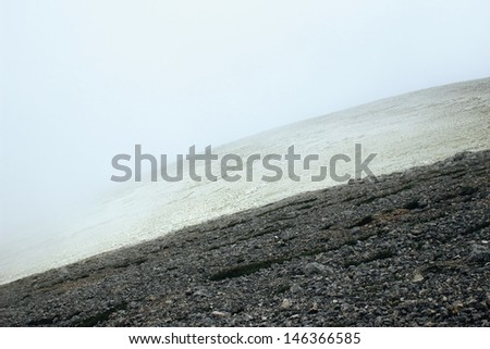 Abstract background with stones and fog - stock photo