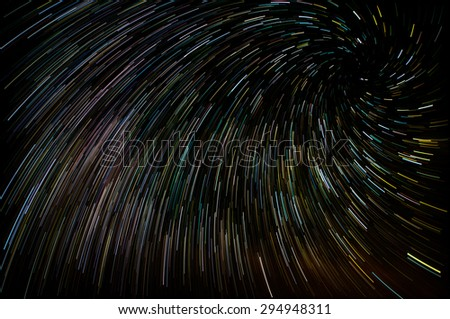 Abstract background with vortex star trails - stock photo