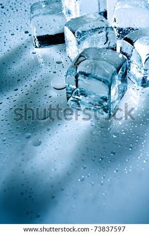 abstract backgrounds with ice cubes over wet glass - stock photo