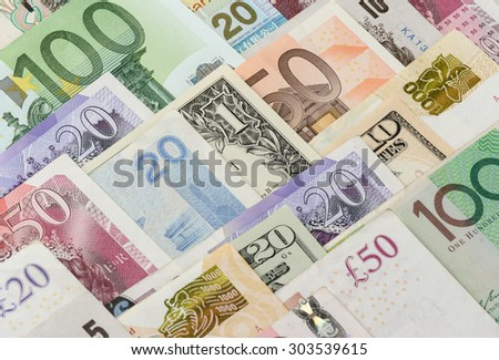 abstract bank notes from different countries - stock photo
