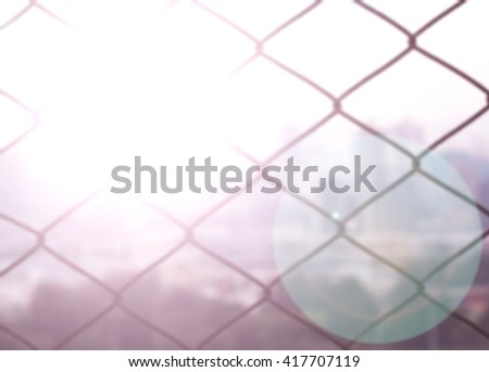 abstract Barbed wire background. warm sky sunny color Orange light patterns plain abstract flare evening chain city fence barbed wire prohibited liberty freedom sharp expectations poison fair mesh  - stock photo