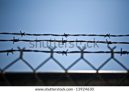 Abstract barbwire fence wish copy space - stock photo