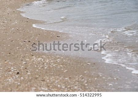 abstract beach background.Motion blur wave of the sea on the beach.