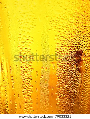 Abstract beer background with water drops - stock photo