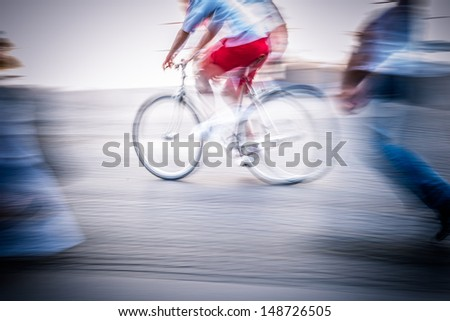 abstract biker in the street - stock photo