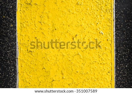 Abstract black and yellow metal background.