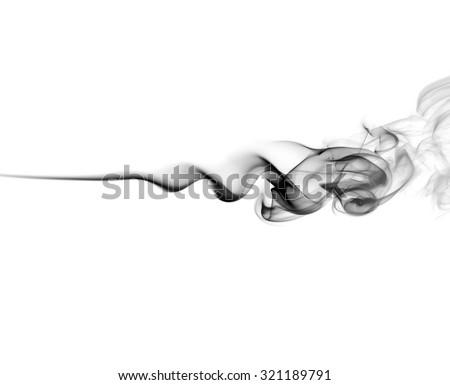 Abstract black smoke swirls on white background. Photo. - stock photo