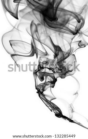 Abstract black smoke swirls over white background - stock photo