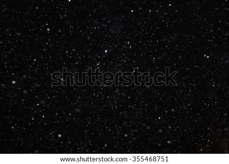 Abstract black white snow texture on black background for overlay - stock photo