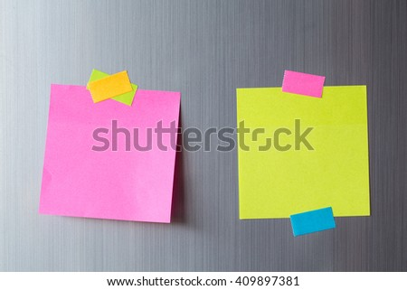 Abstract Blank paper and stick paper on refrigerator door. paper note copy space for add text. - stock photo