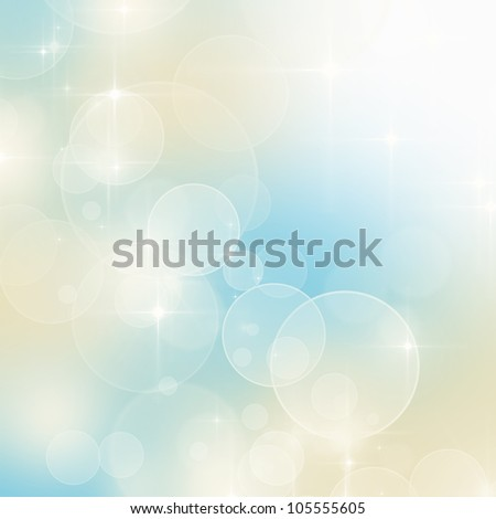 Abstract blue and beige bokeh background with copy space - stock photo