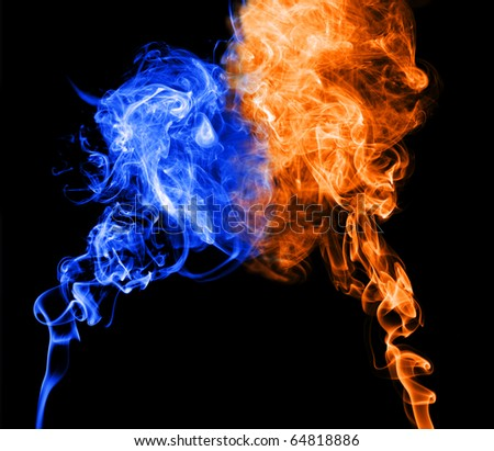 Abstract blue and red smoke puff join into heart shape, symbol of cold and warm character of love. - stock photo