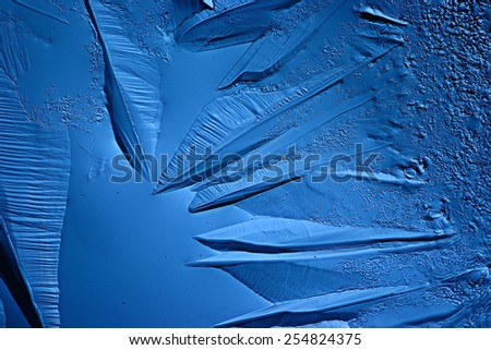 abstract blue background cold ice texture with cracks - stock photo