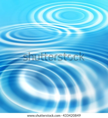 Abstract blue background with concentric ripples