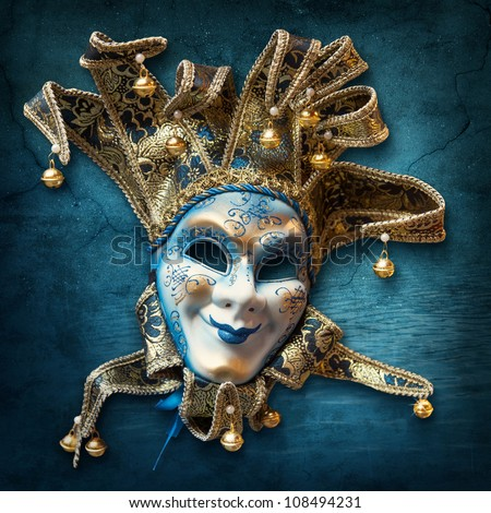 Abstract blue background with venetian mask - stock photo