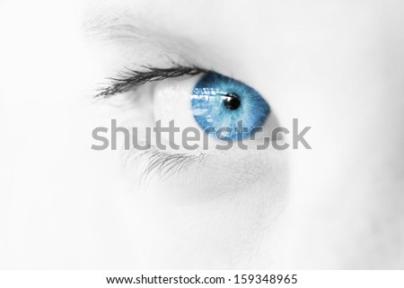 Abstract Blue Eye macro in limited palette, staring from the side  - stock photo