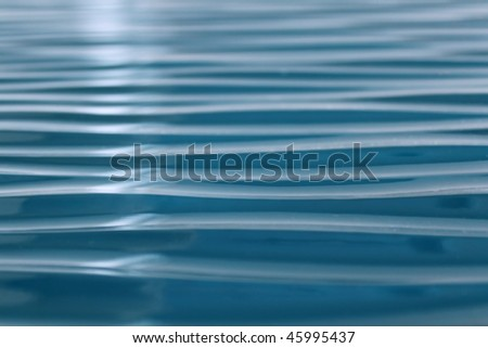 Abstract blue flow water surface. - stock photo