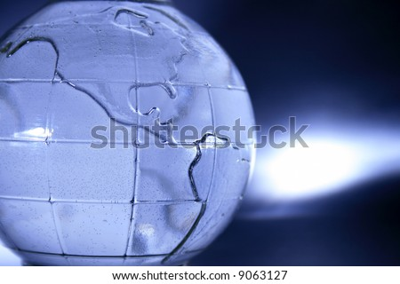 abstract blue glass globe (water inside and small bubbles) - stock photo