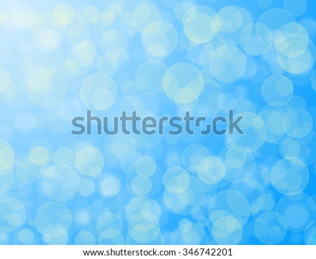 Abstract blue holiday background bokeh effect - stock photo