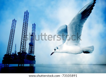 Abstract blue oil rig and flying seagull in a personal blueprint. - stock photo