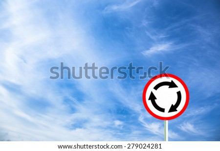 Abstract blue sky with Roundabout crossroad road traffic sign - stock photo