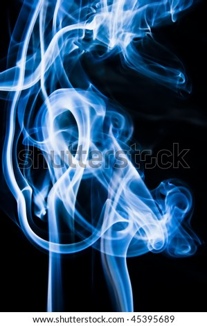 Abstract blue smoke shot against black background - stock photo