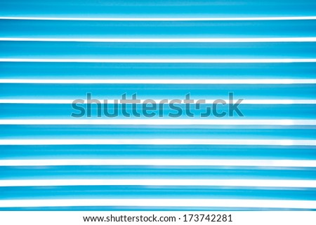 Abstract blue venetian blinds - stock photo