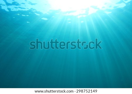 Abstract blue water background underwater sunlight - stock photo
