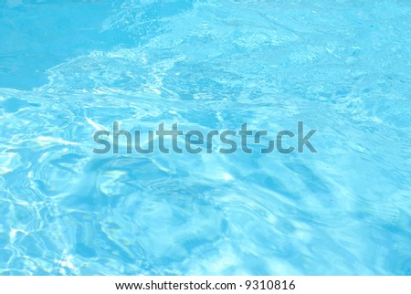 Abstract blue Water of a Swimming Pool . - stock photo