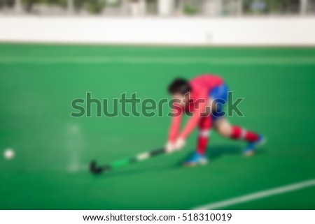 Abstract blur. Abstract blur of Hockey players on the turf.