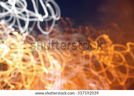 Abstract blur background, color lights into motion over dark - stock photo
