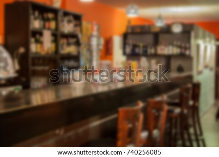 Abstract Blur Background of Bar Counter for Alcohol Beverages in Cafeteria or Pub Restaurant