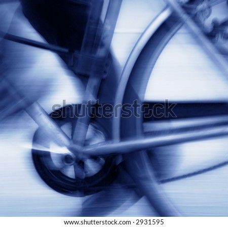 Abstract blur background of bicycle pedal, chain and rear wheel in motion, blue tone - stock photo