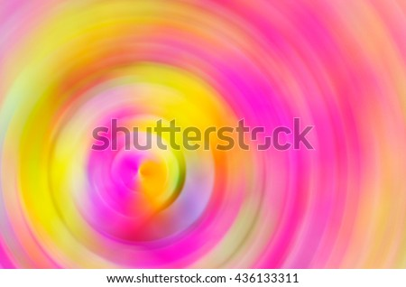Abstract blur background of circle spinning in yellow pink tone