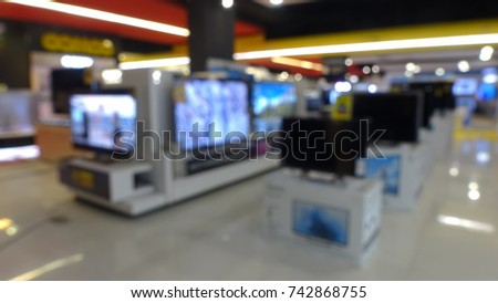 Abstract Blur Background of Eletronic Department Store or Retail Store. TV or Television shelf Shopping Display