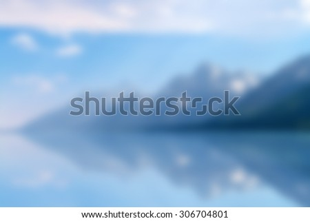 Abstract blur background of Grand Teton Mountain Range, part of Rocky Mountain Range or Rockies, with Jackson Lake reflection in Yellowstone Wyoming WY USA National Park - stock photo