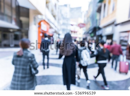 Abstract blur background of people walking on street at Macau