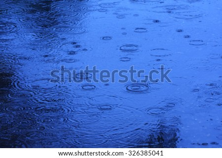Abstract blur background of raining flow down on the floor, blue tone. - stock photo
