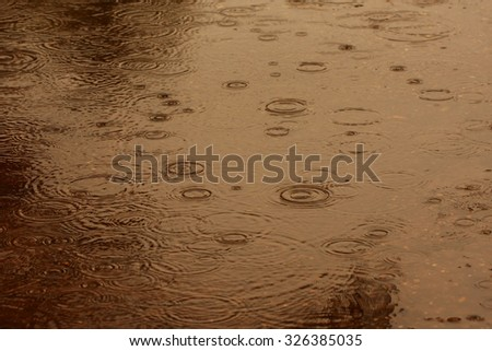 Abstract blur background of raining flow down on the floor, brown tone. - stock photo