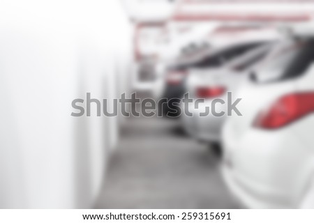 Abstract blur background of The back of car at the parking lot with wall space, shallow depth of focus - stock photo